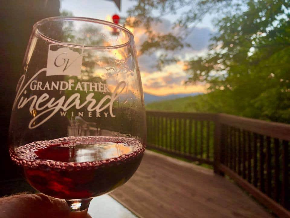 grandfather red wine in a glass on a porch in north carolina mountains
